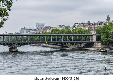 PARIS, FRANCE - JUNE 12, 2018: View of pont de Bir-Hakeim (formerly pont de Passy) - a bridge that crosses the Seine River. Central arch decorated with monumental statues.