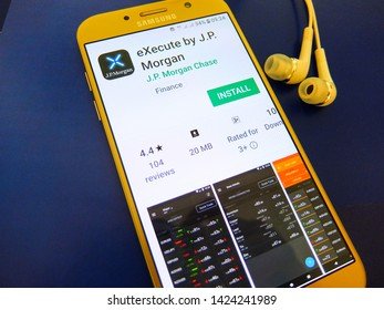 Paris, France. June 12, 2019 - execute by JP Morgan application on smartphone screen close up. the JP Morgan FX and commodity trading app is for clients to manage their business on the go.