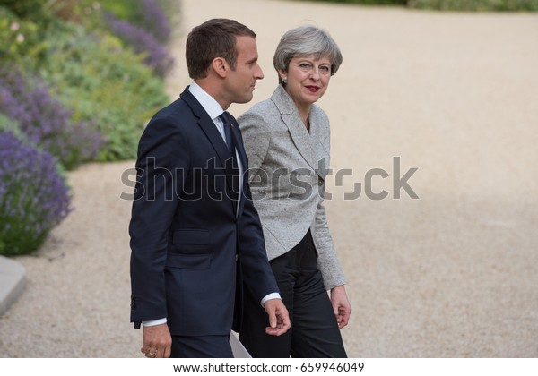 PARIS, FRANCE - JUNE 13, 2017 : The Prime Minister of United Kingdom Theresa May  walking with the french President Emmanuel Macron  in the gardens of Elysee Palace after a working visit.