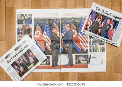 PARIS, FRANCE - JUNE 13, 2018: Multiple International newspapers with cover U.S. President Donald Trump meeting North Korean leader Kim Jong-un in Singapore