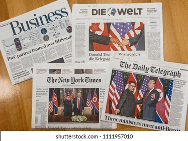 PARIS, FRANCE - JUNE 13, 2018: International newspapers with cover U.S. President Donald Trump meeting North Korean leader Kim Jong-un in Singapore