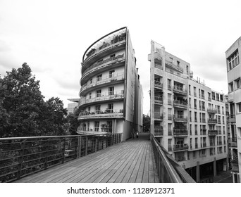 "PARIS, FRANCE - JUNE 14, 2018: Parisian architecture. Building ""cut in two parts"" at the end of Viaduc des Arts promenade at Avenue Daumesnil in12th arrondissement of Paris. Black and white photo."