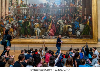 Paris, France - June 15, 2018: A group of school children visiting the Louvre Museum on a day trip.