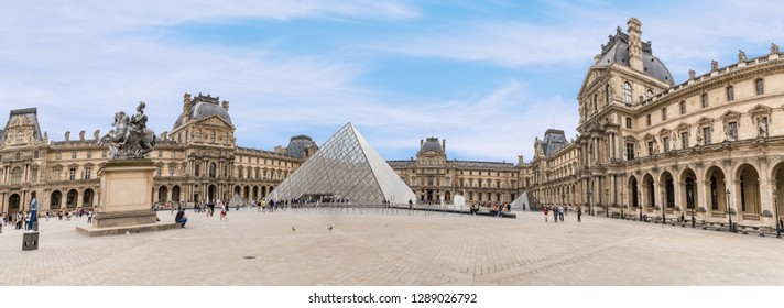 PARIS, FRANCE - June 15, 2018: The Louvre Art Museum Building, Glass Pyramid panoramic.