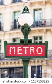 Paris, France - June 16, 2017:  Retro metro (subway) sign at the entrance to the subway station.