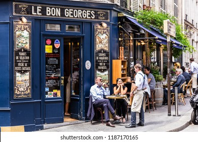 Paris, France - June 16, 2017: The charming Cafe Le Bon Georges. Parisians and tourists enjoy food and drinks at the street french cafe.