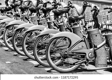 Paris, France - June 16, 2017: Some bicycles of the Velib bike rental service. With the bicing sharing service people can rent bicycles for short trips. Black and white.