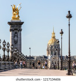 Paris, France - June 17, 2017: Pont Alexandre III bridge over the River Seine and the Hotel des Invalides in the background in the sunny summer morning.