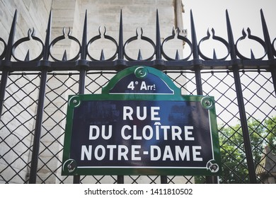 PARIS, FRANCE - JUNE 18, 2014: Rue du cloitre Notre Dame street sign on fence in Paris, France