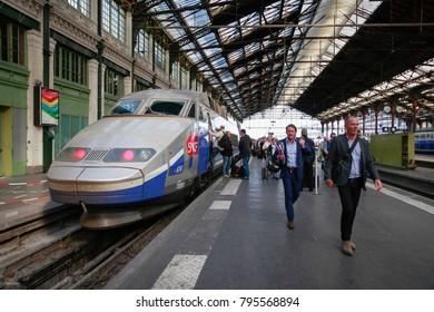 PARIS, FRANCE - JUNE 18, 2014: TGV train and passengers at Gare de Lyon station in Paris, France