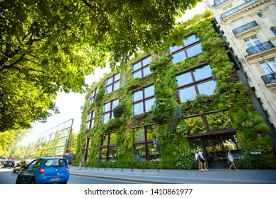Paris, France - June 19, 2017: View of Green architecture concept. Building exterior covered with plants in modern Paris city.