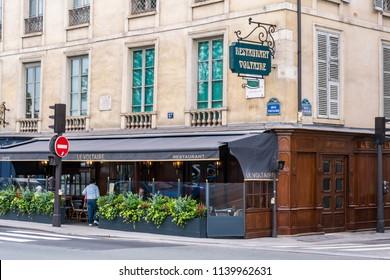Paris, France - June 19, 2018: Restaurant Voltaire on the left bank of River Seine.