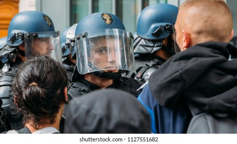 Paris, France - June 1st, 2018: French riot police in a protest in Paris for the sans papiers migrants