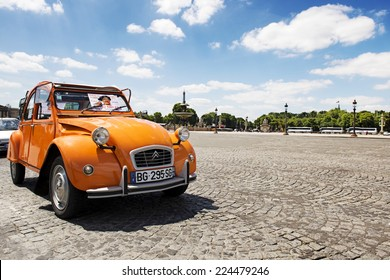 PARIS, FRANCE - JUNE 20, 2014: Old Citroen 2CV parked at Place de la concorde, Paris, France. Citroen 2CV is a French produced car, built from 1948 through 1990 with a unconventional look.