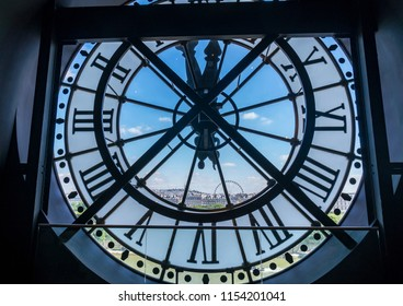 Paris, France - June 20, 2018: Looking out at central Paris from a giant see-through clock of Musee d'Orsay (the Orsay Museum),