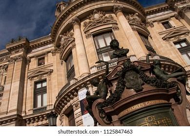 Paris, France, June 2018: Close view of some details on the facade of the Palais Garnier opera house. Place de l'Opera of Paris