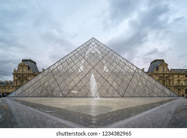 PARIS, FRANCE - JUNE 2018: Closeup and low angle view of the Louvre glass Pyramid. Louvre Museum is one of the largest and most visited museums worldwide.