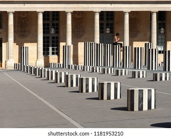 Paris, France - June, 2018: Daniel Buren columns in Palais royal. Palais Royal square and palace located in Paris opposite the north wing of the Louvre