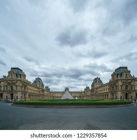 PARIS, FRANCE - JUNE 2018:  Front view of famous Louvre Museum. Louvre Museum is one of largest and most visited museums worldwide.