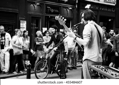 PARIS, FRANCE - JUNE 21, 2014: Celebration of World Music Day in Latin Quarter in Paris. This festival, created in 1981, encourage amateur and professional musicians to perform in the streets.