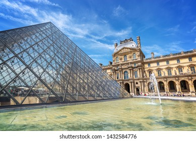 PARIS, FRANCE - June 21: Louvre pyramid in the main courtyard of the Louvre Palace, on June 21, 2018 in Paris France