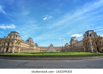 PARIS, FRANCE - June 21:  Symmetric view of the main courtyard of the Louvre palace with the historical buildings and the modern pyramid, on June 21, 2018 in Paris france