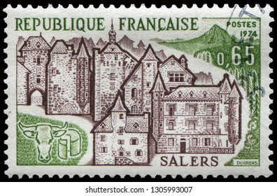 Paris, France - June 22, 1974: View of Salers, famous  commune for its cheeses Cantal and Salers in in south-central France. Stamp issued by French Post in 1974.