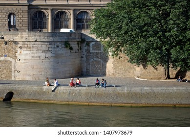 PARIS, FRANCE, June 22: the Parisians and visitors of city resting on a hot sunny day on the embankment Seine River June 22, 2012 in Paris. Embankment the River Seine between the Louvre and Notre Dame
