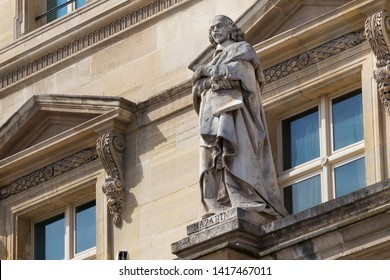 PARIS, FRANCE - JUNE 23, 2017: Cardinal Jules Mazarin (1602-1661) statue on the Louvre. He was politician and chief minister to the king Louis XIV. The famous character of artistic works of A. Dumas.