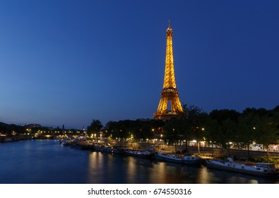 PARIS, FRANCE - June 23, 2017: river Seine and Eiffel tower at night