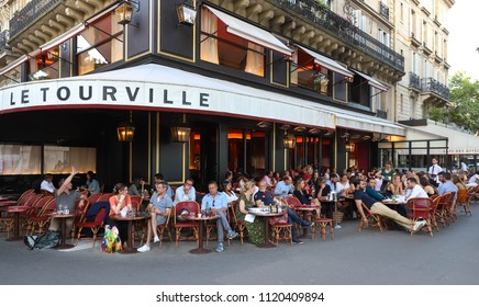 PARIS, FRANCE - June 23, 2018: Cafe Tourville is typical French cafe located near the Eiffel tower in Paris, France.
