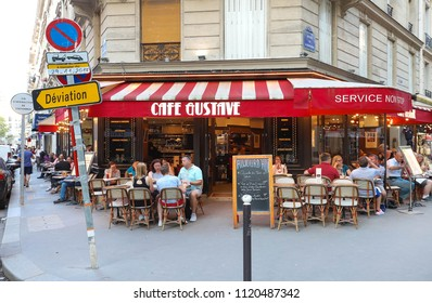 PARIS, FRANCE - June 23, 2018: Cafe Gustave is typical French cafe located near the Eiffel tower in Paris, France.