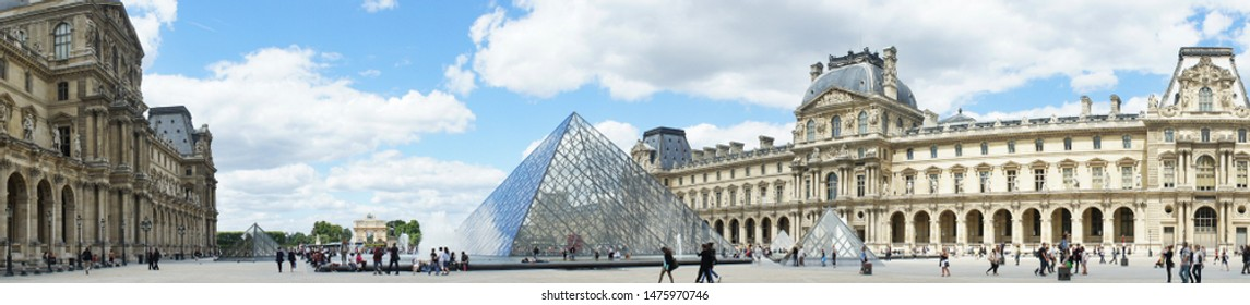 Paris, France - June 24, 2011: panoramic photgraphy of scene in the Louvre museum filled with tourists