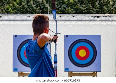Paris, France - June 24, 2017 :  Man practising archery during the Paris Olympic Games 2024 showcase.