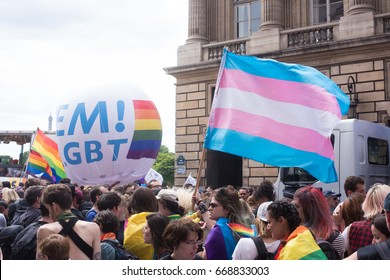 PARIS, FRANCE - JUNE 24, 2017: Trans flag floats above the crowd at the Gay Pride.
