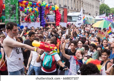PARIS, FRANCE - JUNE 24, 2017: Boy shoots water on the crowd at the Gay Pride.