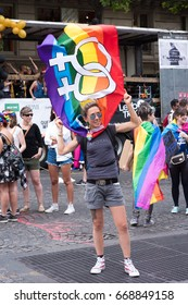 PARIS, FRANCE - JUNE 24, 2017: Lesbian woman holds lesbian flag at the Gay Pride.