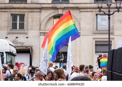 PARIS, FRANCE - JUNE 24, 2017:  Rainbow flag floats above the crowd at the Gay Pride.