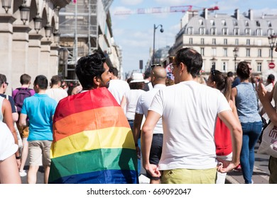 PARIS, FRANCE - JUNE 24, 2017: Gay couple march at the Gay Pride parade.