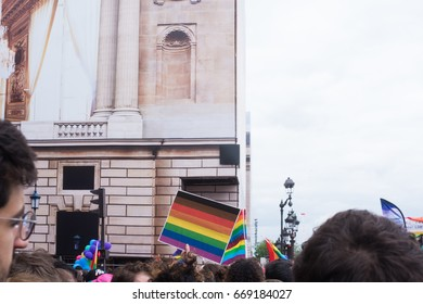 PARIS, FRANCE - JUNE 24, 2017: New black and brown stripes on rainbow flag at the Gay Pride parade.
