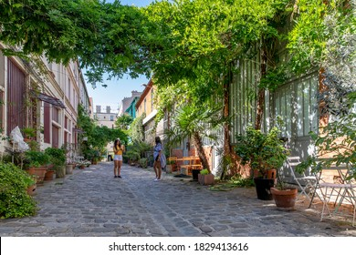 Paris, France - June 24, 2020: Cite des figuiers: One of the romantic courtyards in the East of Paris, France. These bucolic, unusual and hidden spots are delightful gems to explore