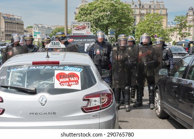 PARIS, FRANCE - JUNE  25, 2015 :  French police (riot squad) try to control the protest of the taxis against the service Ubber Pop at the Porte Maillot.