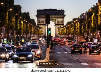 Paris, France - June 25, 2017: The Avenue des Champs Elysees and Arc de Triomphe (Arch of Triumph of the Star) in the summer at night.