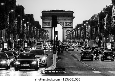 Paris, France - June 25, 2017: The Avenue des Champs Elysees and Arc de Triomphe (Arch of Triumph of the Star) in the summer at night. Black and white