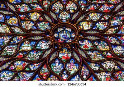 Paris, France - June 25, 2018: Colorful religious stained glass rose windows in the Saint Chapel (Sainte Chapelle).