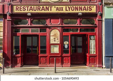 "PARIS, FRANCE - JUNE 26, 2017: View ""Aux Lyonnais"" with original sign ""Maison Lyonnaise"": a Parisian bistro dedicated to cuisine of Lyon. This traditional ""Bouchon Lyonnais"" in Paris opened in 1890."
