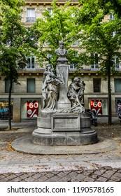 PARIS, FRANCE - JUNE 26, 2017: Monument to French philosopher Auguste Comte (Isidore Marie Auguste Francois Xavier Comte) on Sorbonne square (Place de la Sorbonne) in Paris; inaugurated in 1902.