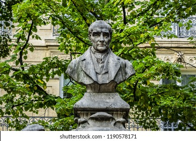 PARIS, FRANCE - JUNE 26, 2017: Monument to French philosopher Auguste Comte (Isidore Marie Auguste Francois Xavier Comte) on Sorbonne square (Place de la Sorbonne) in Paris; inaugurated in 1902.
