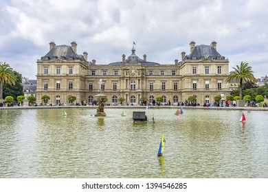PARIS, FRANCE - JUNE 26, 2017: Beautiful pond with Children's ships near Luxembourg Palace in Luxembourg Garden (Jardin du Luxembourg - second largest Public Park in Paris).