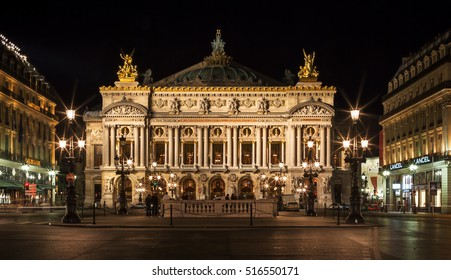 Paris, France - June 27, 2006: Night front view of the Opera National de Paris. Grand Opera (Opera Garnier) is famous neo-baroque building in Paris. Designed by Charles Garnier in 1875.